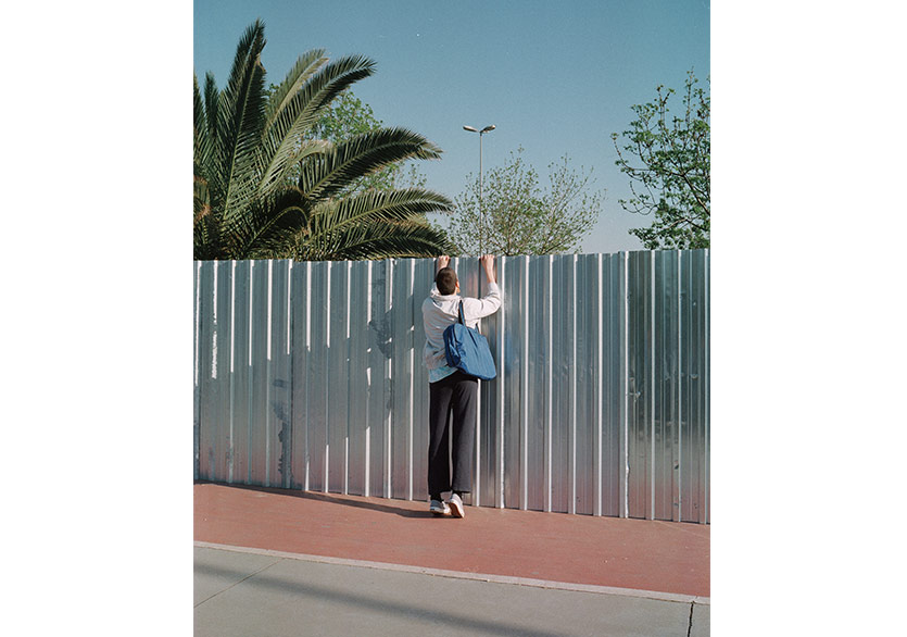 Anders Tye Skjoldjensen, (Picture of guy looking over fence) Omer and the fence, 2017