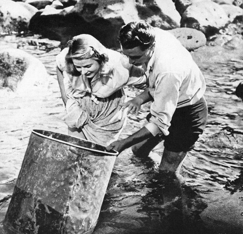 Ingrid Bergman & Mario Vitale, Huysuz'un çevresindeki kadınlara balıkçı koca fantazması kurduran film Stromboli'den bir sahne, 1950.
