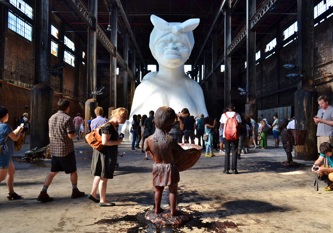 "Installation view of Kara Walker, ""A Subtlety, or the Marvelous Sugar Baby,"" presented by Creative Time at the Domino Sugar Refining Plant, 2014. Photo by gigi_nyc, via Flickr. https://www.artsy.net/article/the-art-genome-project-what-secrets-do-these-sketches-reveal-about-8-iconic-artworks"